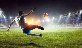 Soccer player on stadium in action. Mixed media stock images