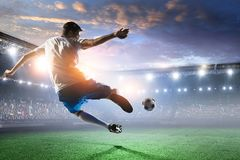 Soccer player on stadium in action. Mixed media royalty free stock images