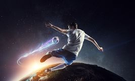 Soccer player on stadium in action. Mixed media stock photos