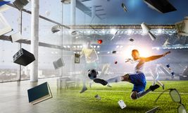 Soccer player on stadium in action. Mixed media stock photo