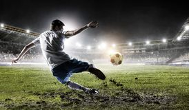 Soccer player at stadium. Mixed media royalty free stock images