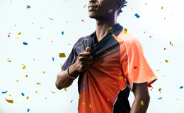 Soccer player stand in white background confetti Royalty Free Stock Image