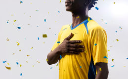 Soccer player stand in white background confetti Stock Images