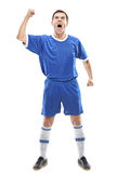Soccer player standing and screaming Stock Photography