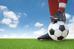 Soccer player standing with soccer ball Royalty Free Stock Photography
