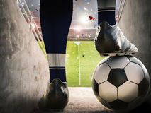 Soccer player standing with soccer ball Stock Photo