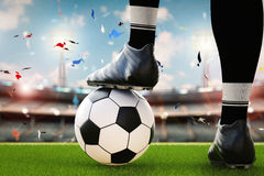 Soccer player standing with soccer ball Stock Photography