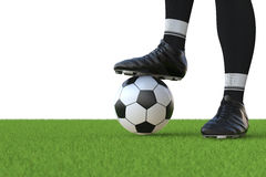 Soccer player standing with soccer ball Royalty Free Stock Images