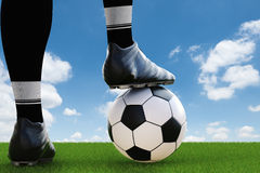 Soccer player standing with soccer ball Royalty Free Stock Photos