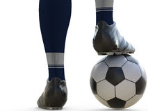 Soccer player standing with soccer ball Royalty Free Stock Image