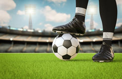 Soccer player standing with soccer ball Stock Image