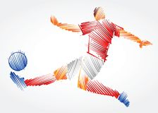 Soccer player stretching the body to dominate the ball. Made of colorful brushstrokes on light background Stock Photo