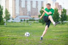Soccer player strongly hits the ball Royalty Free Stock Images