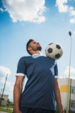 Soccer player training with ball on soccer pitch Royalty Free Stock Photo