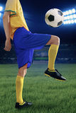 Soccer player training to control the ball Stock Photos