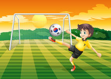A soccer player using the ball with the flag of South Korea Royalty Free Stock Images