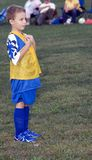 Soccer Player Waiting. Young soccer player standing waiting start of game Royalty Free Stock Photography