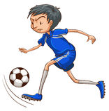 A soccer player wearing a blue uniform Royalty Free Stock Image
