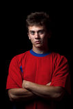 Soccer player whit arms crossed Stock Images