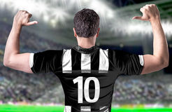 Soccer player on white and black tshirt in the stadium Stock Image