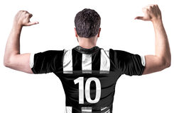 Soccer player on white and black tshirt on white background Royalty Free Stock Images