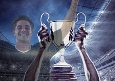 Soccer player wining the cup and two images are superimpose stock photography