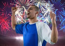 soccer player wining, firework behind him Royalty Free Stock Photography