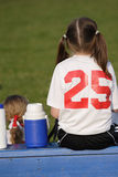 Soccer Playeron Bench. Girl soccer player on bench during game with pony tails Stock Photos