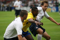 Soccer players. Two US soccer team players are trying to stop the ecuatorian player. This game was played in Barquisimeto - Venezuela. It belongs to the Copa royalty free stock image