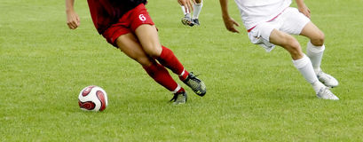 Soccer players. Running after the ball Royalty Free Stock Photography