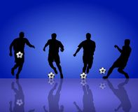 Soccer Players. An illustrated soccer background with silhouettes of players playing on a blue backdrop Royalty Free Stock Photography