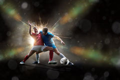Soccer players in action. Football soccer players in action isolated on color background Royalty Free Stock Photography