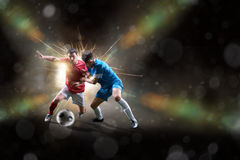 Soccer players in action. Football soccer players in action isolated on color background Royalty Free Stock Image