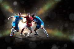 Soccer players in action. Football soccer players in action isolated on color background Stock Images