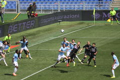 Soccer players in action. At a football match Lazio Sampdoria Italian football Championship 2013 - 2014 Royalty Free Stock Photos