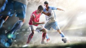 Soccer players in action on the grand stadium background panorama royalty free stock photos