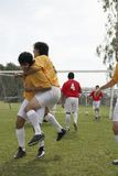 Soccer players celebrating goal Royalty Free Stock Images