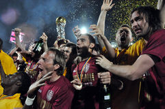 Soccer players celebrating with the golden cup Royalty Free Stock Photo