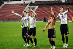 Soccer players celebrating a victory Royalty Free Stock Images