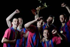 Soccer players celebrating victory Royalty Free Stock Photo