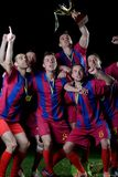 Soccer players celebrating victory Stock Images