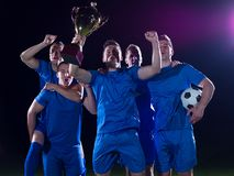 Soccer players celebrating victory Royalty Free Stock Images