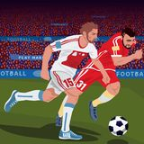 Soccer players from different teams. Football gameplay. Two soccer players from different teams, running for ball on football field, front side view, spectator Royalty Free Stock Photo