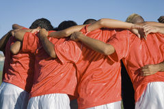 Soccer Players Discussing Strategy. Rear view of young soccer players discussing strategy Royalty Free Stock Photos