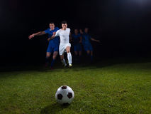 Soccer players duel Stock Photo