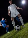 Soccer players duel Stock Photography