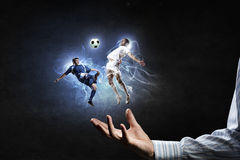 Soccer players fighting for ball stock image