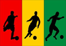 Soccer players and flag of Guinea Stock Images