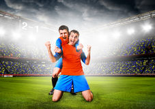 Soccer players. Soccer or football players are celebrating goal on stadium Royalty Free Stock Photos