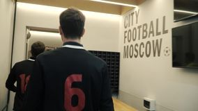 Soccer players in the locker room. Clip. Football team in the locker room. Team is preparing for a football match in the. Locker room stock footage